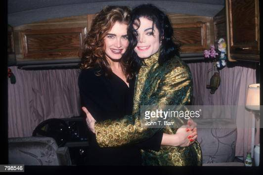 Michael Jackson and actor Brooke Shields hug at the Grammy Awards February 26 1993 in Los Angeles CA Jackson was presented with the Legend Award for...