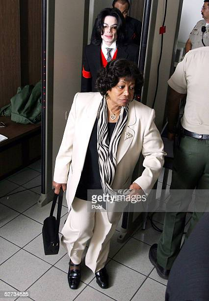 Michael Jackson and his mother Katherine Jackson pass thorough a magnetometer as they reenter the courtroom at the Santa Barbara County courthouse...