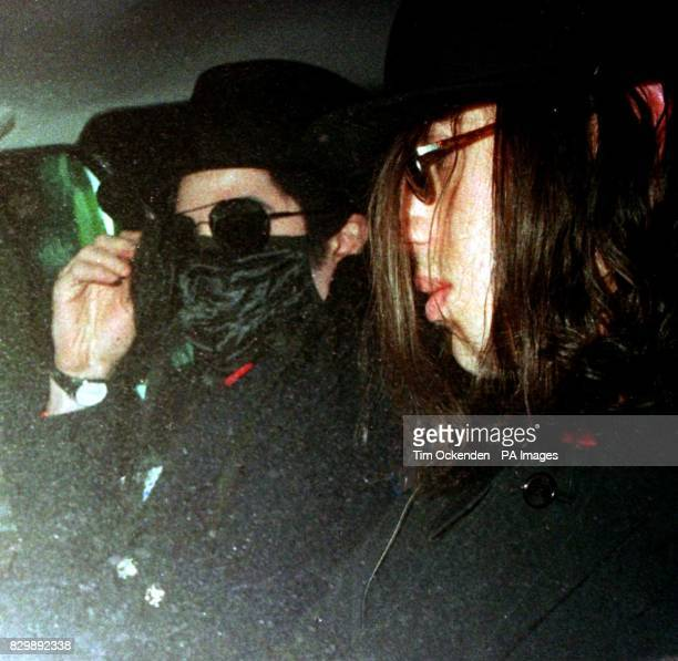 Michael Jackson and his mystery travelling companion pictured leaving Heathrow Airport this evening after jetting in on Concorde from New York...