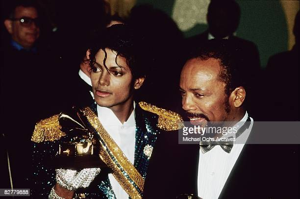 Michael Jackson and his producer Quincy Jones pose with their Grammys on February 28 1984 at the 26th annual Grammy Awards in Los Angeles California