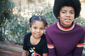 Michael Jackson and his sister Janet pose for a photo at their Hollywood Hills home on December 18 1972 in Los Angeles California