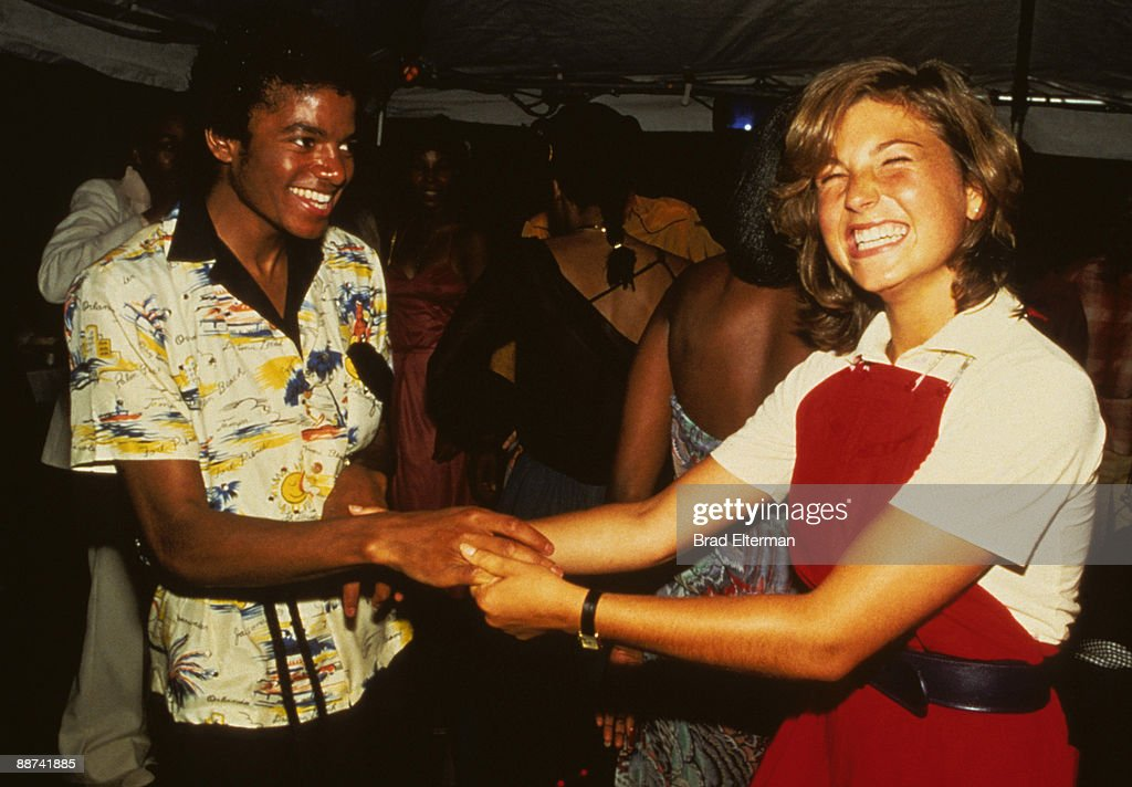 Michael Jackson and Tatum O' Neal dance at a party held inside a bank in celebration of The Jackson's gold records in Los Angeles, California. **EXCLUSIVE**