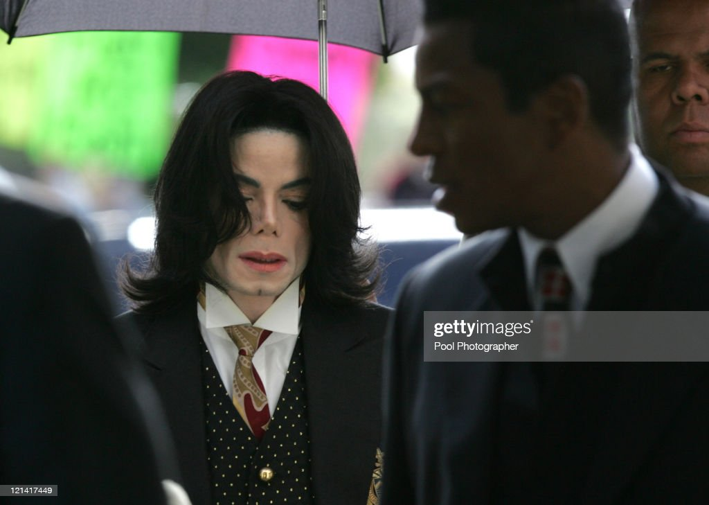 <a gi-track='captionPersonalityLinkClicked' href=/galleries/search?phrase=Michael+Jackson&family=editorial&specificpeople=70011 ng-click='$event.stopPropagation()'>Michael Jackson</a> arrives as his defense continues to present its case during <a gi-track='captionPersonalityLinkClicked' href=/galleries/search?phrase=Michael+Jackson&family=editorial&specificpeople=70011 ng-click='$event.stopPropagation()'>Michael Jackson</a>'s child molestation trial at the Santa Barbara County Courthouse in Santa Maria May 9, 2005. Pool Photo by <a gi-track='captionPersonalityLinkClicked' href=/galleries/search?phrase=Justin+Sullivan&family=editorial&specificpeople=4756014 ng-click='$event.stopPropagation()'>Justin Sullivan</a>/Getty