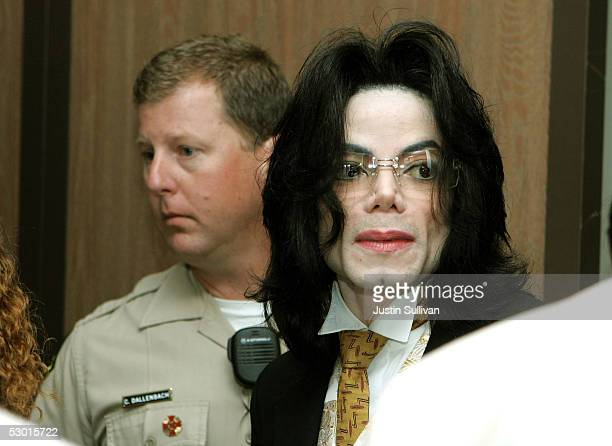 Michael Jackson arrives at the Sana Barbara County Courthouse for the second day of closing arguments in his child molestation trial June 3 2005 in...