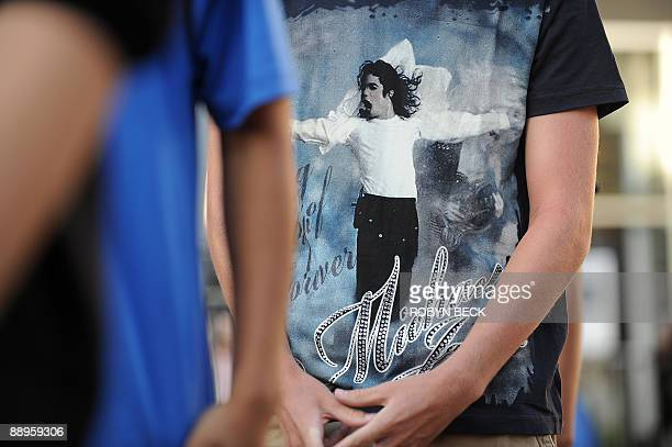 Michael Jackson fans wait in line to take part in a moonwalk contest at a oneday tribute to the 'King of Pop' which included outdoor screenings of...
