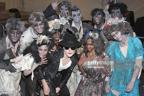 Michael Jackson impersonator Pete Carter poses with contestants from the Bravo TV series 'Step It Up and Dance' at the drivein presentation of...