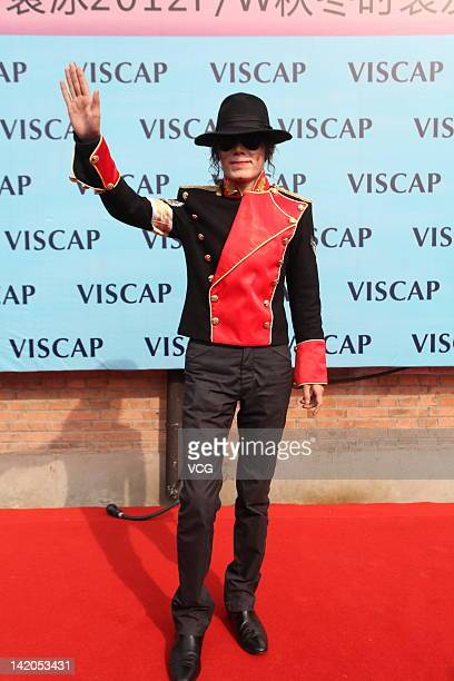 A Michael Jackson impersonator poses for photos ahead of the Viscap Yuan Bing collection show on the fourth day of China Fashion Week Fall/Winter...