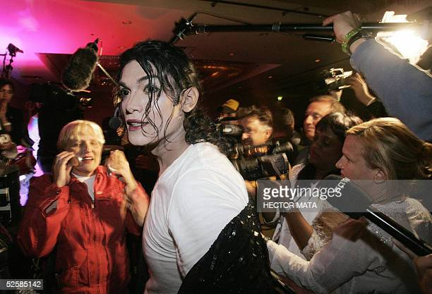 Michael Jackson impersonator reacts as Jackson's delivers a speech via celphone during a fan club gathering in an hotel in Santa Maria California 03...