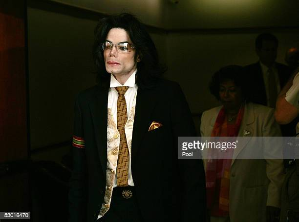 Michael Jackson leaves the courtroom on a break at the Santa Barbara County Courthouse for the second day of closing arguments in his child...