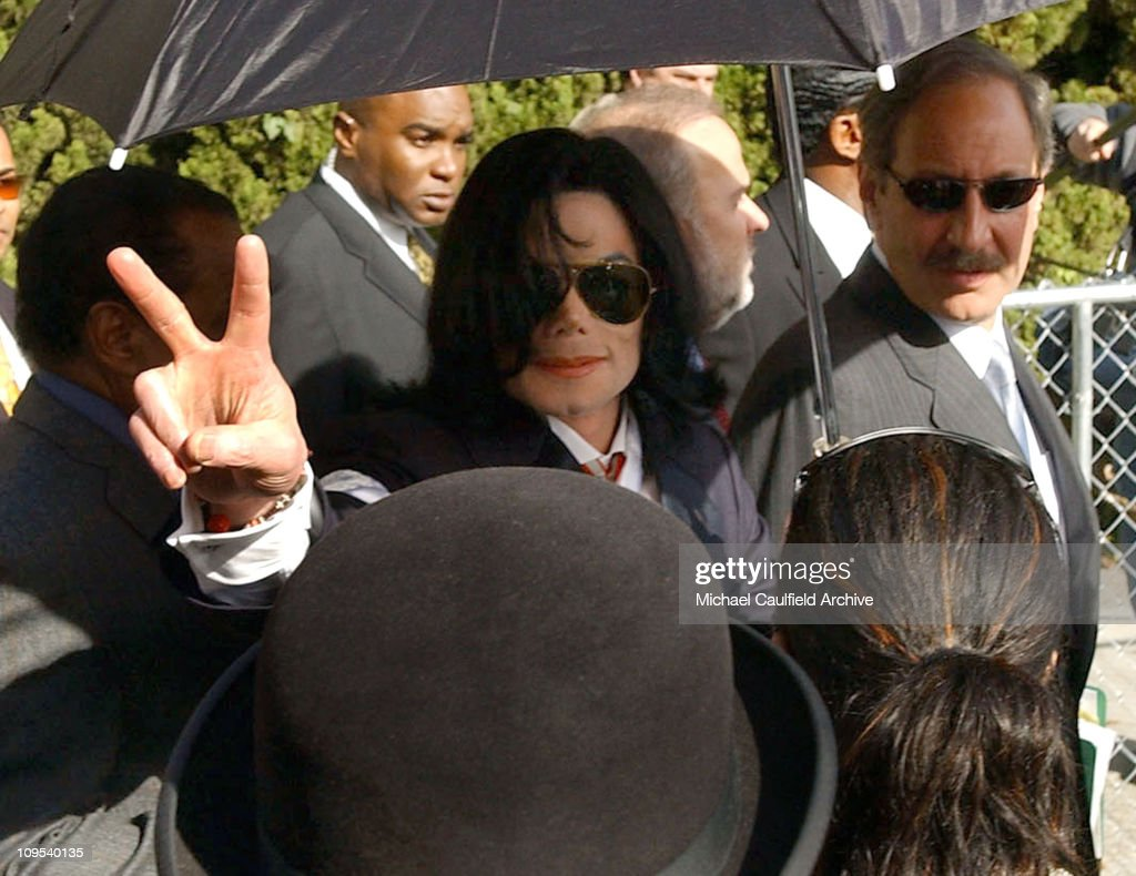 Michael Jackson leaves the Santa Maria Courthouse with his sister Janet Jackson and Mark Geragos Friday Jan 16 2004