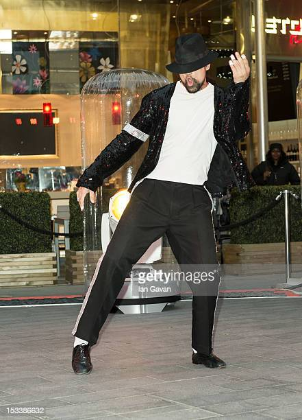 Michael Jackson lookalike performs outside during the VIP Preview of 'The Collection Of Tomkins And Bush Michael Jackson Wardrobe' at Getty Gallery...