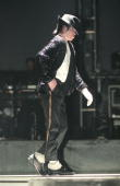 Michael Jackson moonwalks while performing on stage on his HIStory tour in December 1996