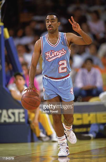 Michael Jackson of the Sacramento Kings dribbles the ball during an NBA game against the Los Angeles Lakers at the Great Western Forum in Los Angeles...