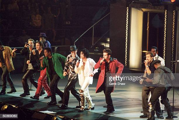 Michael Jackson performing with siblings formerly known asThe Jackson 5 and members of NSYNC at Michael Jackson's 30th anniversary concert