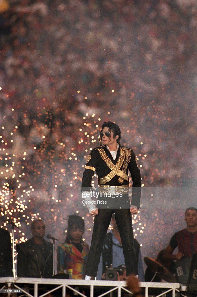 <a gi-track='captionPersonalityLinkClicked' href=/galleries/search?phrase=Michael+Jackson&family=editorial&specificpeople=70011 ng-click='$event.stopPropagation()'>Michael Jackson</a> performs during the Halftime show as the Dallas Cowboys take on the Buffalo Bills in Super Bowl XXVII at Rose Bowl on January 31, 1993 in Pasadena, California. The Cowboys won 52-17.