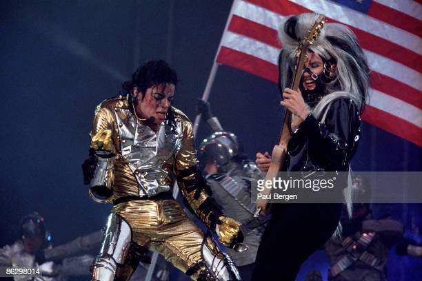 Michael Jackson performs live at The Arena in Amsterdam during the HIStory tour on June 08 1997 Jennifer Batten on guitar