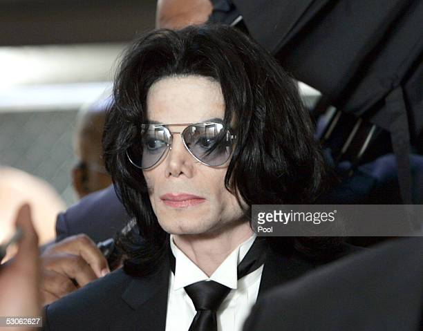 Michael Jackson prepares to enter the Santa Barbara County Superior Court to hear the verdict read in his child molestation case June 13 2005 in...