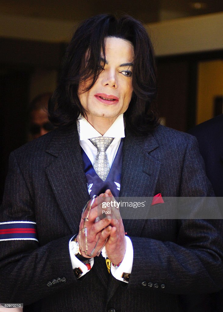<a gi-track='captionPersonalityLinkClicked' href=/galleries/search?phrase=Michael+Jackson&family=editorial&specificpeople=70011 ng-click='$event.stopPropagation()'>Michael Jackson</a> smiles as he leaves the Santa Barbara County Courthouse after a day of his child molestation trial May 23, 2005 in Santa Maria, California. Jackson is charged in a 10-count indictment that included molesting a boy, plying him with liquor and conspiring to commit child abduction, false imprisonment and extortion. He has pleaded innocent.