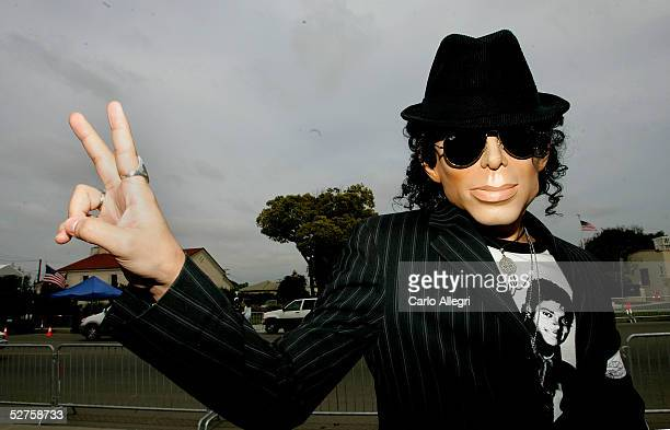 Michael Jackson supporter Hami Jeffry wears a mask and tshit depicting his idol outside the Santa Barbara County courthouse on May 4 2005 in Santa...