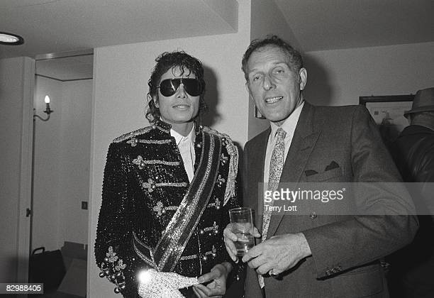 Michael Jackson talking to Maurice Oberstein whilst in London to accept a gold disc for the 'Thriller' album London 1983