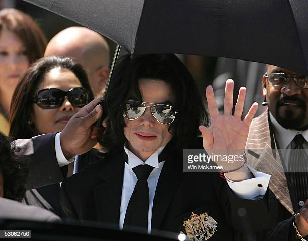 Michael Jackson waves to fans after he is found not guilty on all counts in his child molestation trial at the Santa Barbara County Courthouse June...