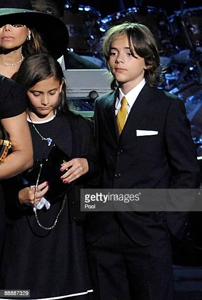 Michael Jackson's children Paris Jackson and Prince Michael Jackson stand on stage at the Michael Jackson public memorial service held at Staples...
