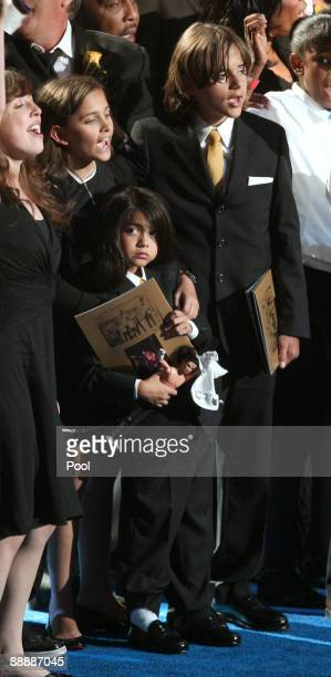 Michael Jackson's children Paris Jackson Prince Michael Jackson II and Prince Michael Jackson stand on stage at the Michael Jackson public memorial...