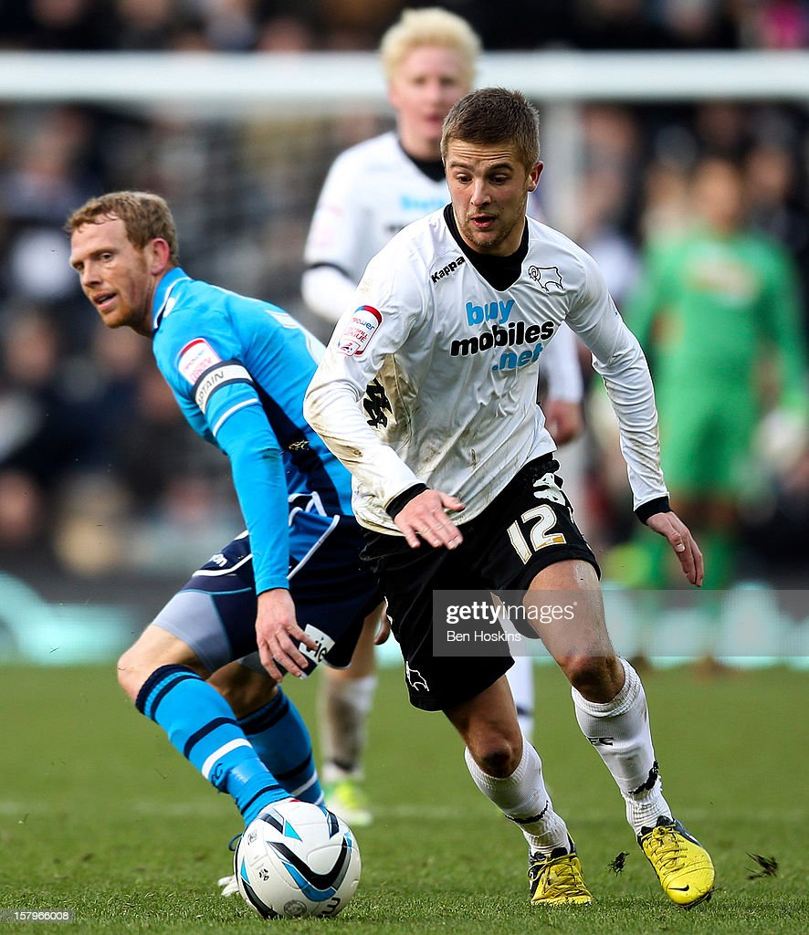 Michael Jacobs of Derby breaks away from the challenge of Paul Green of Leeds during the npower Championship match between Derby County and Leeds United at Pride Park on December 8, 2012 in Derby, England.