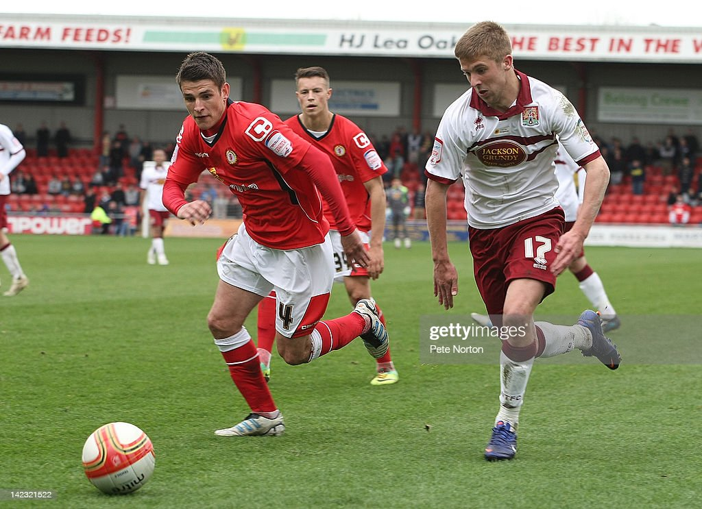 Michael Jacobs #17 of Northampton Town looks for the ball with Ashley Westwood of Crewe Alexandra during the npower League Two match between Crewe Alexandra and Northampton Town at The Alexandra Stadium on March 31, 2012 in Crewe, England.