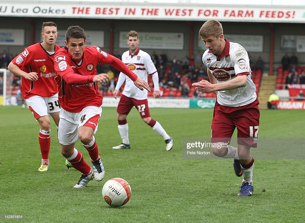 Michael Jacobs of Northampton Town looks for the ball with Ashley Westwood of Crewe Alexandra during the npower League Two match between Crewe...