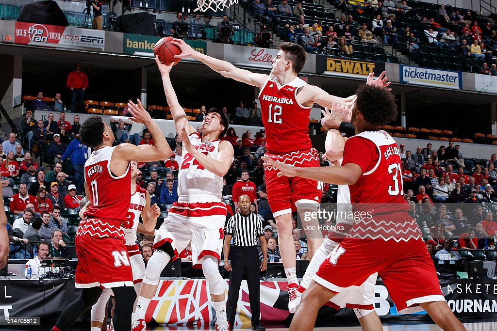 Michael Jacobson #12 of the Nebraska Cornhuskers blocks a shot against <a gi-track='captionPersonalityLinkClicked' href=/galleries/search?phrase=Bronson+Koenig&family=editorial&specificpeople=9510843 ng-click='$event.stopPropagation()'>Bronson Koenig</a> #24 of the Wisconsin Badgers in the second round of the Big Ten Basketball Tournament at Bankers Life Fieldhouse on March 10, 2016 in Indianapolis, Indiana. Nebraska defeated Wisconsin 70-58.