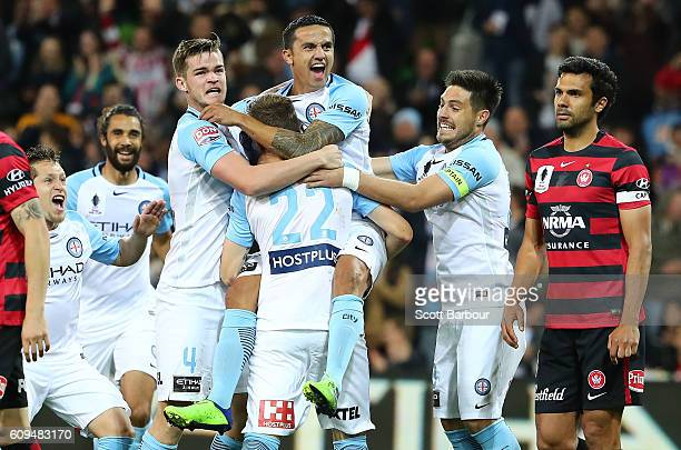 Michael Jakobsen of City is congratulated by Tim Cahill Bruno Fornaroli and his teammates after scoring their first goal during the FFA Cup Quarter...