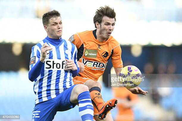 Michael Jakobsen of Esbjerg FB and Elmar Bjarnason of Randers FC compete for the ball during the Danish Alka Superliga match between Esbjerg fB and...