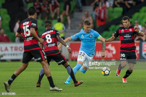 Michael Jakobsen of Melbourne City controls the ball in front of Jaushua Sotirio of the Western Sydney Wanderers Rolieny Bonevacia of the Western...