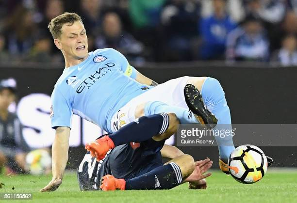 Michael Jakobsen of the City is tackled by Carl Valeri of the Victory during the round two ALeague match between Melbourne Victory and Melbourne City...