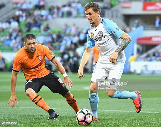 Michael Jakobsen of the City passes the ball infront of Dimitri Petratos of Brisbane Roar during the round nine ALeague match between Melbourne City...