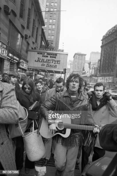 Michael James Brody with guitar surrounded by his many 'followers' in Times Square He drew an instant crowd of people who obviously learned of his...