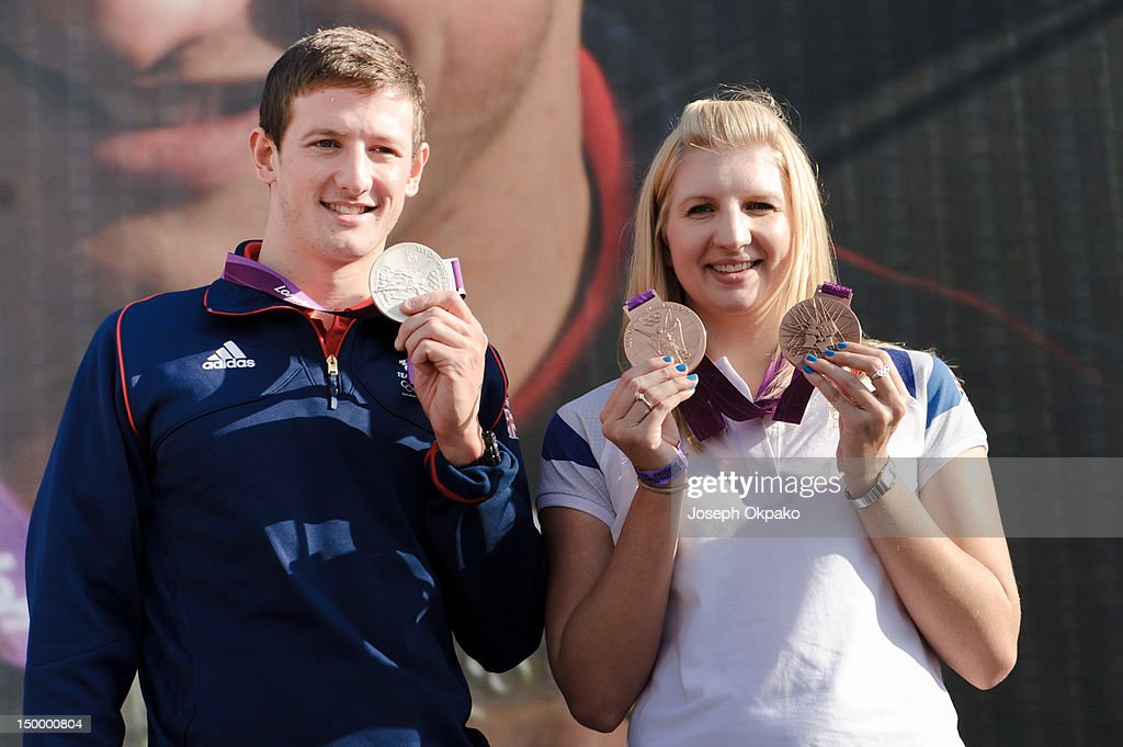 <a gi-track='captionPersonalityLinkClicked' href=/galleries/search?phrase=Michael+Jamieson+-+Swimmer&family=editorial&specificpeople=4878536 ng-click='$event.stopPropagation()'>Michael Jamieson</a>, British Olympic Silver medalist in 200m breaststroke swimming and <a gi-track='captionPersonalityLinkClicked' href=/galleries/search?phrase=Rebecca+Adlington&family=editorial&specificpeople=872897 ng-click='$event.stopPropagation()'>Rebecca Adlington</a>, British Olympic bronze medalist in the 400m and 800m freestyle swimming at London 2012 show off their medals to the crowd at BT London Live at Hyde Park on August 8, 2012 in London, England.