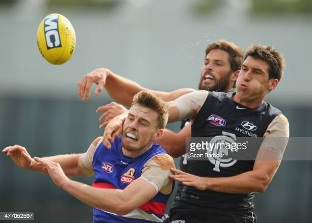 Michael Jamison of the Blues and Jordan Roughead of the Bulldogs compete for the ball during the AFL practice match between the Carlton Blues and...