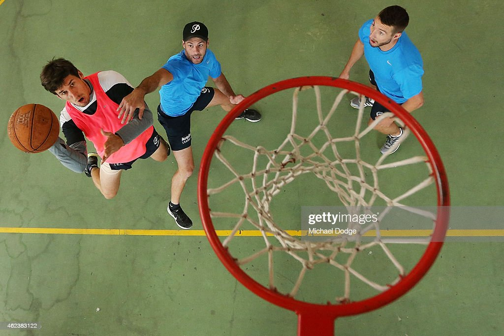 Michael Jamison plays team basketball against Simon White (C) and Dale Thomas in the recreation centre on Mount Buller during the Carlton Blues AFL training camp on January 28, 2015 in Mount Buller, Australia.