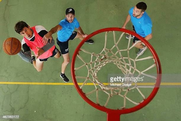 Michael Jamison plays team basketball against Simon White and Dale Thomas in the recreation centre on Mount Buller during the Carlton Blues AFL...