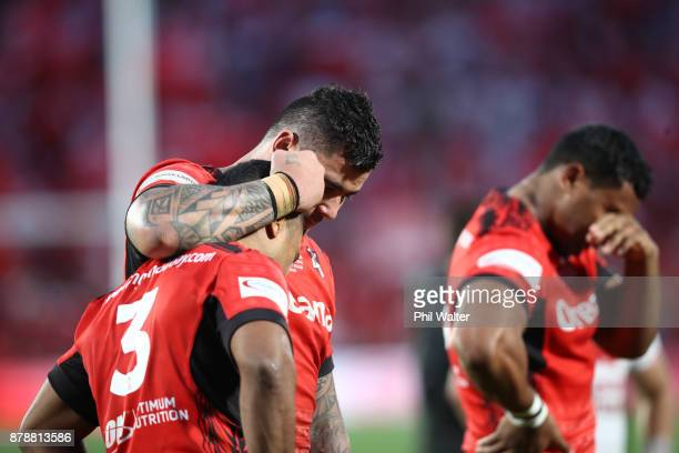Michael Jennings and Andrew Fifita of Tonga console each other following the 2017 Rugby League World Cup Semi Final match between Tonga and England...