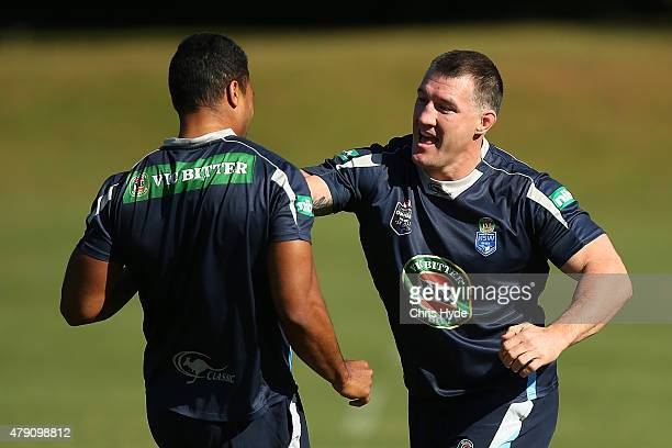 MIchael Jennings and Paul Gallen play tag during a New South Wales State of Origin at Novotel Coffs Harbour on July 1 2015 in Coffs Harbour Australia