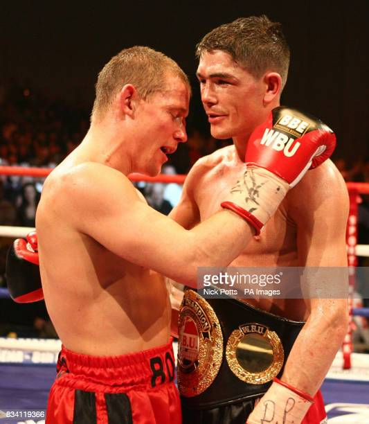 Michael Jennings hugs the defeated Ross Minter following the WBU Welterweight Title bout at ExCel Arena London