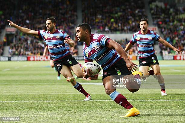 Michael Jennings of Australia crosses the line to score the first try during the Four Nations match between the Australian Kangaroos and England at...