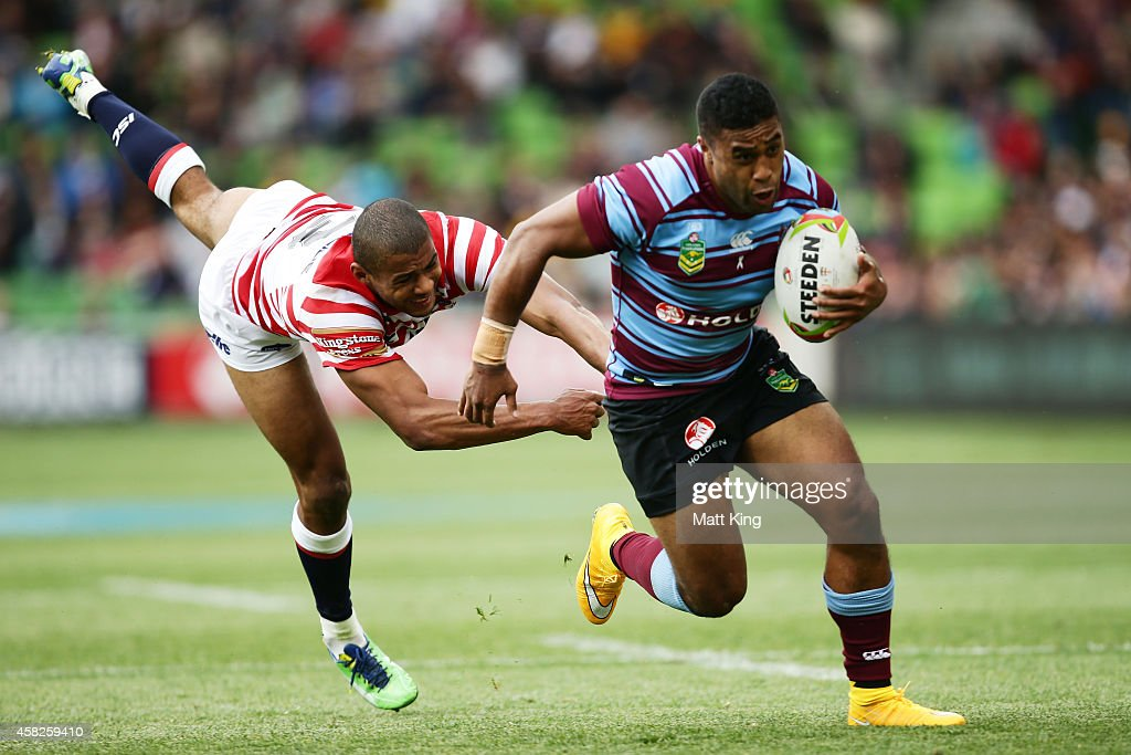 Michael Jennings of Australia evades the tackle of Kallum Watkins of England during the Four Nations match between the Australian Kangaroos and...