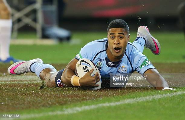 Michael Jennings of the Blues celebrates scoring a try during game two of the State of Origin series between the New South Wales Blues and the...