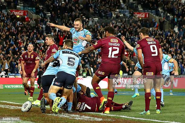 Michael Jennings of the Blues celebrates scoring the winning try during game three of the State Of Origin series between the New South Wales Blues...