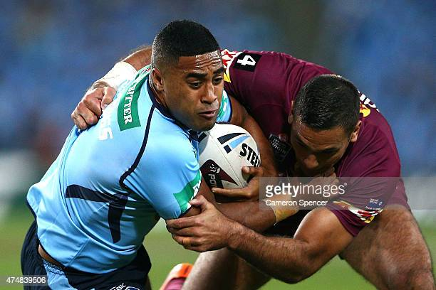 Michael Jennings of the Blues is tackled by Justin Hodges of the Maroons during game one of the State of Origin series between the New South Wales...