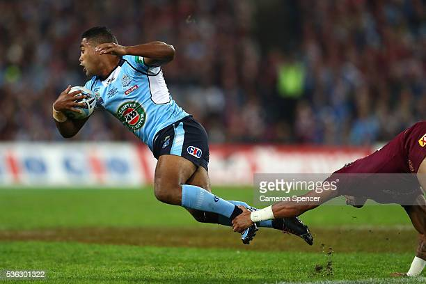 Michael Jennings of the Blues is tackled during game one of the State Of Origin series between the New South Wales Blues and the Queensland Maroons...